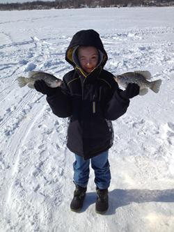 kid with 2 crappies